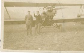John DeVoin and Wilmer Bannister stand in front of a plane … (descriptions935)