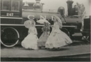 3 women in front of a Canadian National Railways engine wea… (descriptions1063)