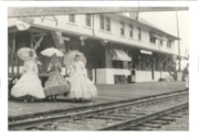 3 women in front of CNR stations dressed in hoopskirts and … (descriptions1071)