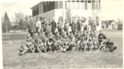 Boy's Hockey Team in front of Smithers High School (descriptions1186)
