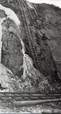 This image shows a ladder from the railroad tracks up a ste… (descriptions1281)