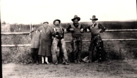 Mrs. Fisher with a boy and three cowboys at the Telkwa Barb… (descriptions1538)