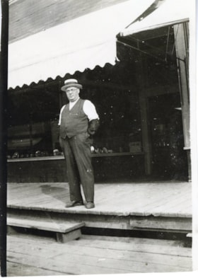Ed Eby in front of Eby's Hardware (descriptions1810)
