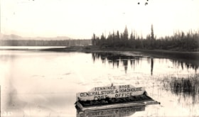 Jennings Bros. sign floating in Lake Kathlyn (descriptions2071)