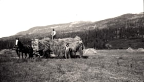 Men with hay wagon, Jack McNeil's Ranch, Telkwa, B.C. (descriptions2569)