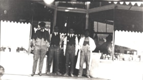 Four men in front of Broughton & McNeil store, Telkwa, B.C. (descriptions2600)