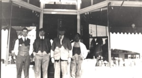 Four men in front of Broughton & McNeil store, Telkwa, B.C. (descriptions2602)