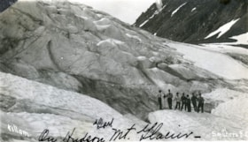 Postcard format. A group of men on Hudson Bay Glacier (descriptions2710)