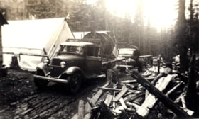 Trucks parked in unidentified tent camp (descriptions7480)
