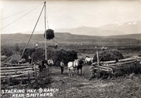 Many men and horses building a haystack outdoors with the o… (descriptions2972)