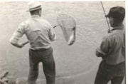 "Written on back of photo ""Johnny Dunlop lands a salmon for … (descriptions3756)"