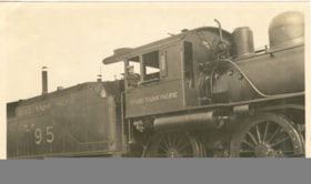 Man sitting in a Grand Trunk Pacific Engine.  The number of… (descriptions3772)