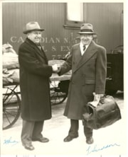 Two men shaking hands in front of CN car (descriptions7552)