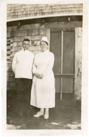 Art Dickson, orderly, and Nurse Callendar in front of the f… (descriptions4827)