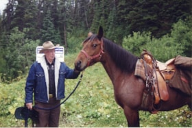 Al Fletcher with horse at opening of Fletcher-Gardiner Trail (descriptions10381)